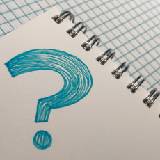 Question mark drawn in notebook